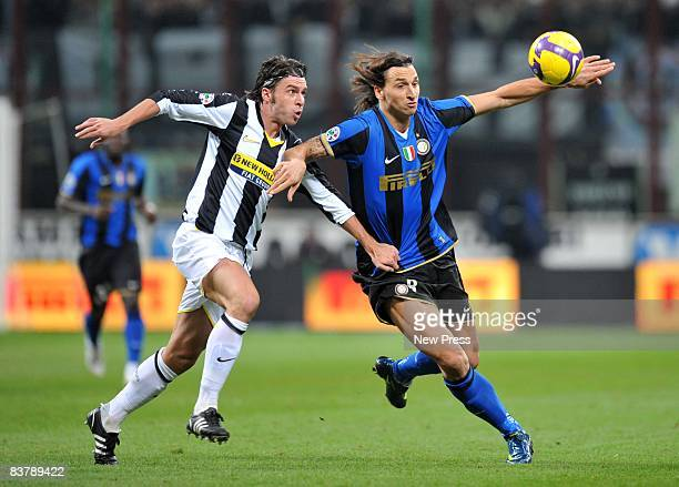 Zdenek Grygera of Juventus and Zlatan Ibrahimovic of FC Inter Milan in action during the Serie A match between FC Inter Milan and Juventus at the...