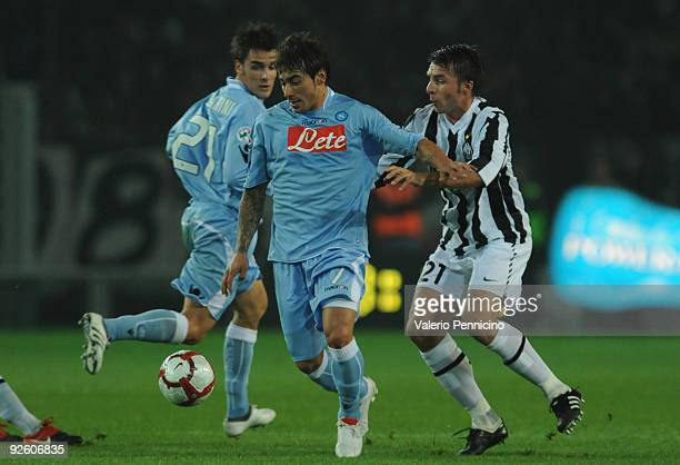 Zdenek Grygera of Juventus FC competes for the ball with Ezequiel Ivan Lavezzi of SSC Napoli during the Serie A match between Juventus FC and SSC...