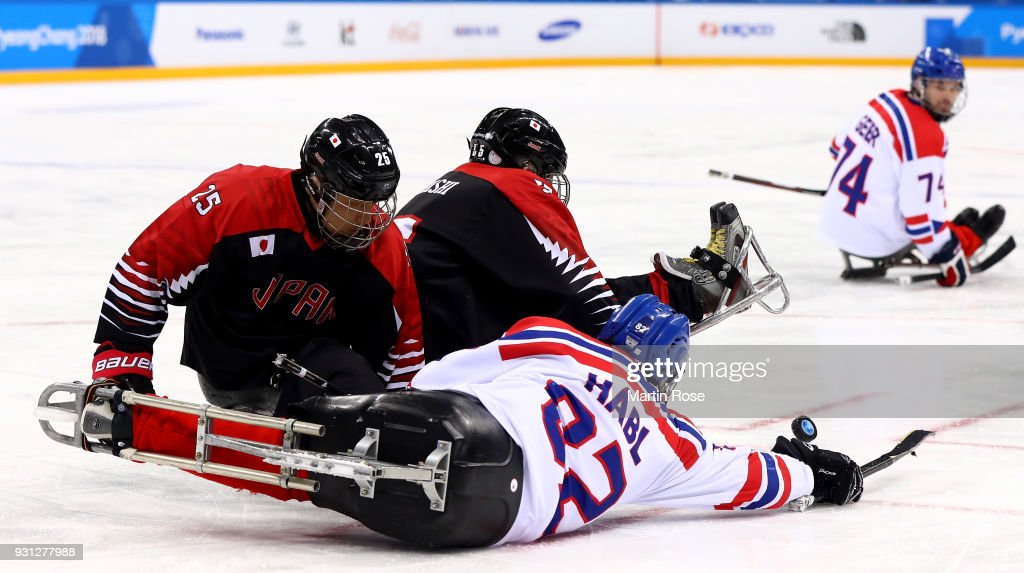Zdenek Habl #82 of Czech Republic battles for the puck with Eiji Misawa of Japan in the Ice Hockey Preliminary Round - Group B game between Czech Republic and Japan during day four of the PyeongChang 2018 Paralympic Games on March 13, 2018 in Gangneung, South Korea.