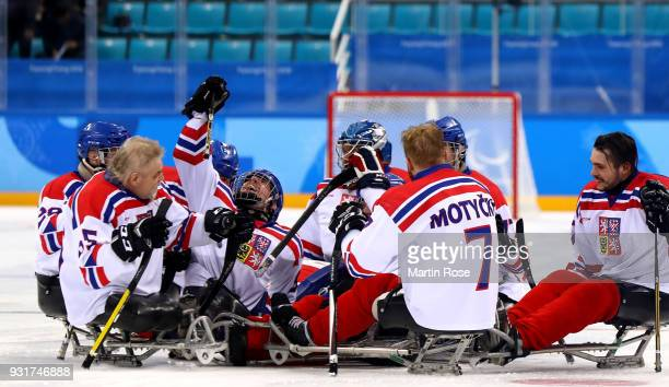 Zdenek Krupicka of Czech Republic celebrate with his team mates after the Ice Hockey Classification game between Czech Republic and Sweden during day...