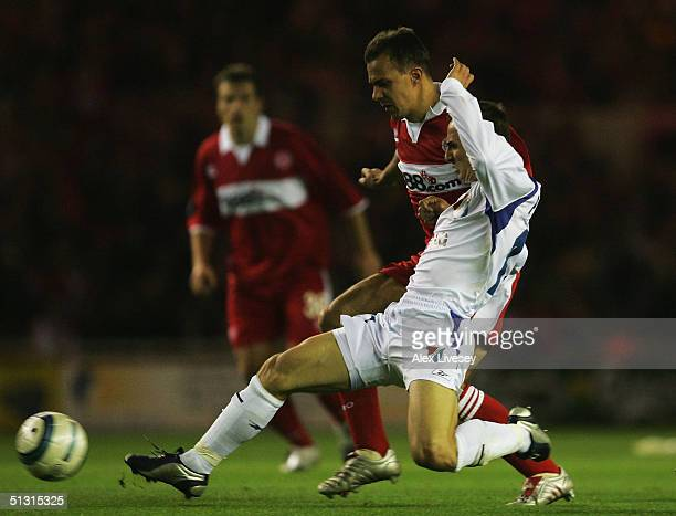 Zdenek Pospech of Banik Ostrava tackles Szilard Nemeth of Middlesbrough during the UEFA Cup first round, first leg match between Middlesbrough and...