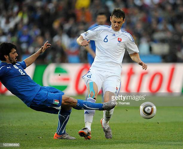 Zdenko Strba of Slovakia tackled by Gennaro Gattuso of Italy during the 2010 FIFA World Cup South Africa Group F match between Slovakia and Italy at...