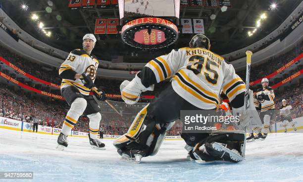 Zdeno Chara and Anton Khudobin of the Boston Bruins react to a shot on goal by the Philadelphia Flyers on April 1 2018 at the Wells Fargo Center in...