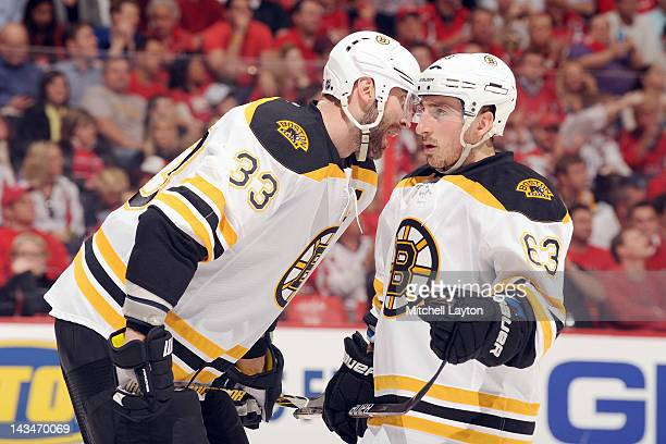 Zdeno Chara and Brad Marchand of the Boston Bruins talk during Game Three of the Eastern Conference Quarterfinals of the 2012 NHL Stanley Cup...