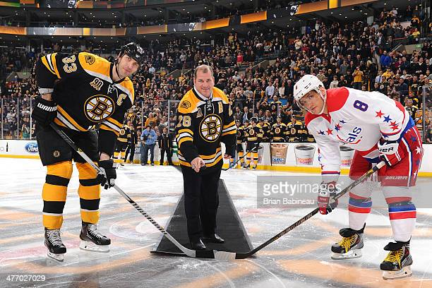 Zdeno Chara and former player Mark Recchi of the Boston Bruins pose for the ceremonial puck drop with Alex Ovechkin of the Washington Capitals at the...