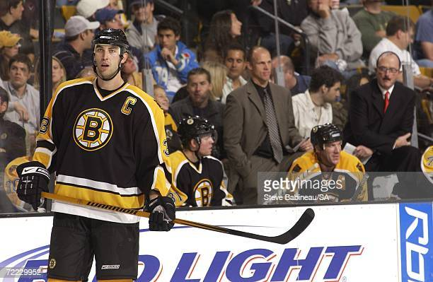 Zdeno Chara and new head coach Dave Lewis of the Boston Bruins wait for a faceoff against the Calgary Flames at the TD Banknorth Garden on October 19...