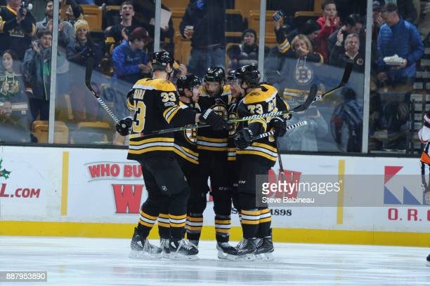 Zdeno Chara Brad Marchand Patrice Bergeron David Pastrnak and Charlie McAvoy of the Boston Bruins celebrate a goal 15 seconds into the first period...