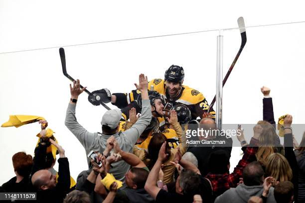Zdeno Chara celebrates with Chris Wagner of the Boston Bruins after Wagner scored a third period goal against the Carolina Hurricanes in Game One of...