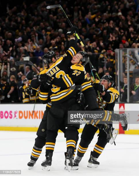 Zdeno Chara, Charlie McAvoy, Brad Marchand celebrate with Patrice Bergeron of the Boston Bruins after he scored the game winning goal against the...