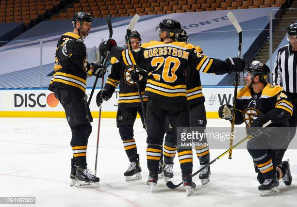 Zdeno Chara Charlie McAvoy Joakim Nordstrom Sean Kuraly and Chris Wagner of the Boston Bruins celebrate after Wagner scored in the third period of a...