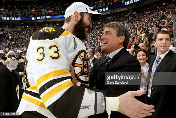 Zdeno Chara of the Boston Bruins and Bruins president Cam Neely celebrate after the Bruins won the Stanley Cup by defeating the Vancouver Canucks 40...