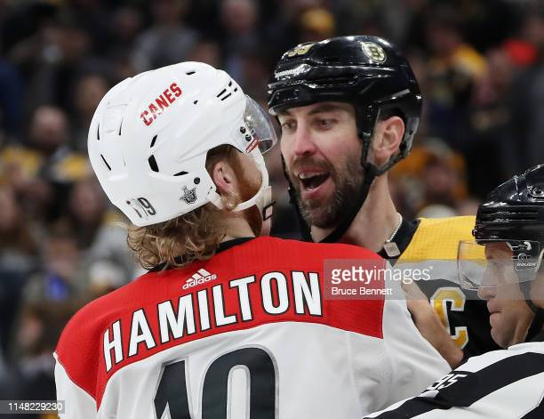 Zdeno Chara of the Boston Bruins and Dougie Hamilton of the Carolina Hurricanes have words in Game One of the Eastern Conference Final during the...