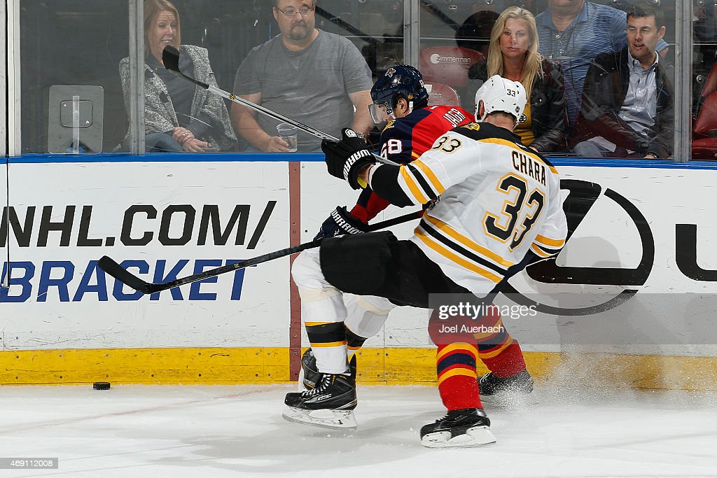 Zdeno Chara #33 of the Boston Bruins and Jaromir Jagr #68 of the Florida Panthers come together along the boards during third period action at the BB&T Center on April 9, 2015 in Sunrise, Florida. The Panthers defeated the Bruins 4-2.