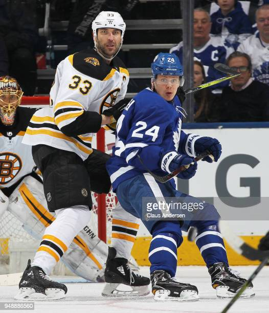Zdeno Chara of the Boston Bruins and Kasperi Kapanen of the Toronto Maple Leafs keep an eye on a bouncing puck in Game Four of the Eastern Conference...