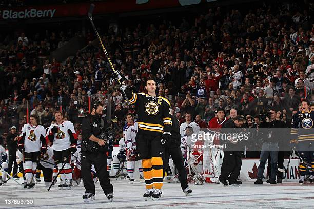 Zdeno Chara of the Boston Bruins and Team Chara celebrates after hitting the puck 108 MPH during the Blackberry NHL Hardest Shot part of the 2012...