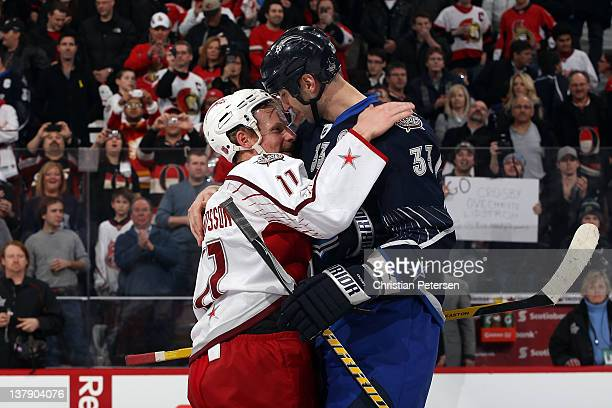 Zdeno Chara of the Boston Bruins and Team Chara hugs Daniel Alfredsson of the Ottawa Senators and Team Alfredsson after defeating Team Alfredsson in...