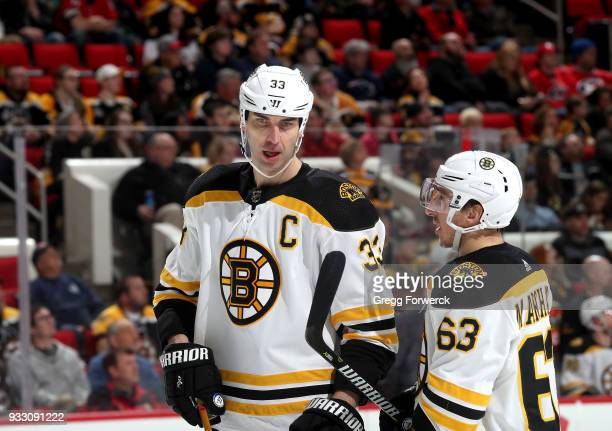 Zdeno Chara of the Boston Bruins and teammate Brad Marchand converse prior to a faceoff against the Carolina Hurricanes during an NHL game on March...