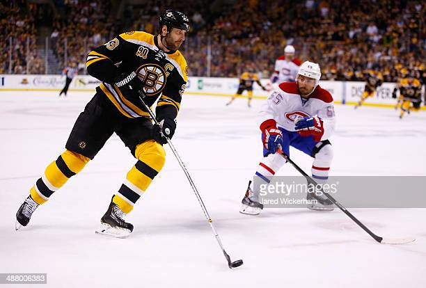 Zdeno Chara of the Boston Bruins carries the puck in front of Francis Bouillon of the Montreal Canadiens in the first period in Game Two of the...