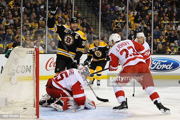 Zdeno Chara of the Boston Bruins celebrates a goal against the Detroit Red Wings in Game Two of the First Round of the 2014 Stanley Cup Playoffs at...