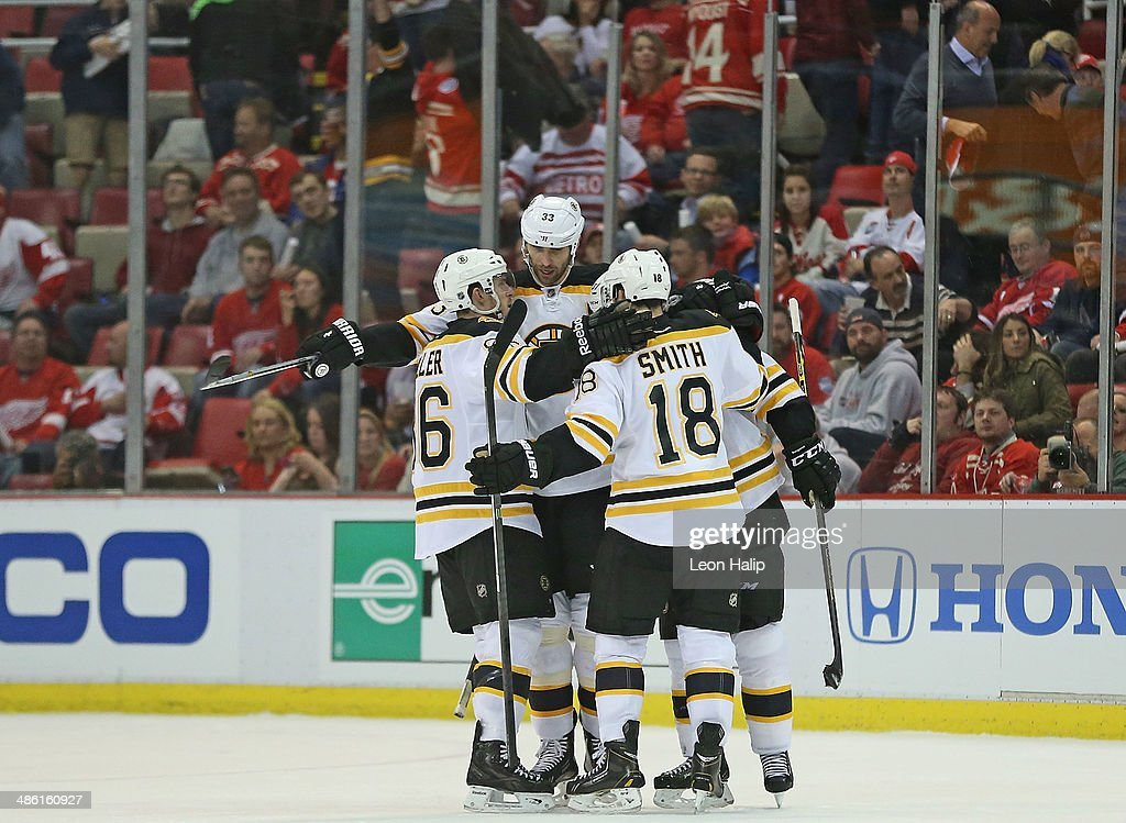 Zdeno Chara #33 of the Boston Bruins celebrates a late third period open net goal with his teammates during Game Three of the First Round of the 2014 NHL Stanley Cup Playoffs at Joe Louis Arena on April 22, 2014 in Detroit, Michigan. The Bruins defeated the Wings 3-0.