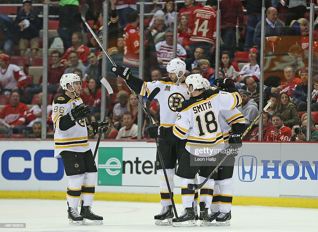 Zdeno Chara #33 of the Boston Bruins celebrates a late third-period open-net goal with teammates during Game Three of the First Round of the 2014 NHL Stanley Cup Playoffs at Joe Louis Arena on April 22, 2014 in Detroit, Michigan. The Bruins defeated the Wings 3-0.