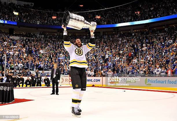 Zdeno Chara of the Boston Bruins celebrates as he lifts the Stanley Cup after his team defeated the Vancouver Canucks 40 in Game Seven of the 2011...