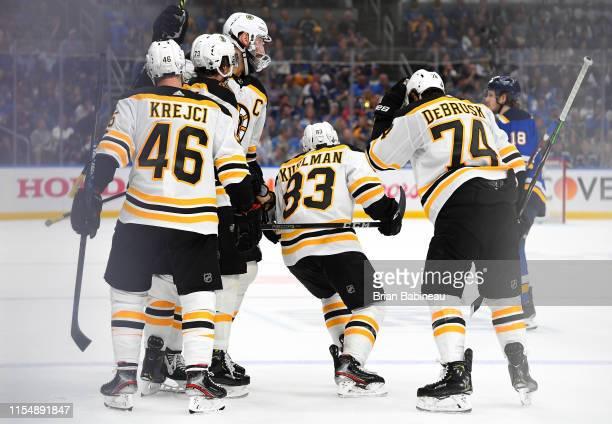 Zdeno Chara of the Boston Bruins celebrates with teammates David Krejci Karson Kuhlman Charlie McAvoy and Charlie McAvoy of the Boston Bruins after...