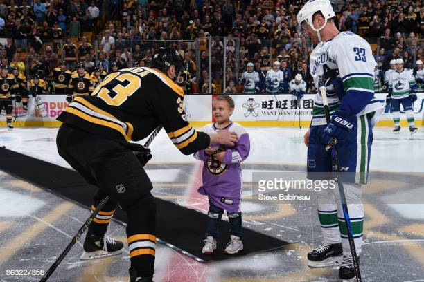 Zdeno Chara of the Boston Bruins chats with 8 year old Layla Flint who is in remission from acute lymphoblastic leukemia and dropping the puck on...