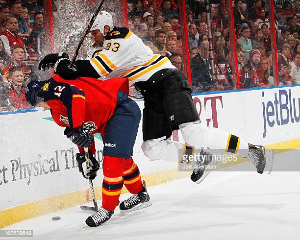 Zdeno Chara of the Boston Bruins checks Jack Skille of the Florida Panthers into the boards at the BBT Center on February 24 2013 in Sunrise Florida