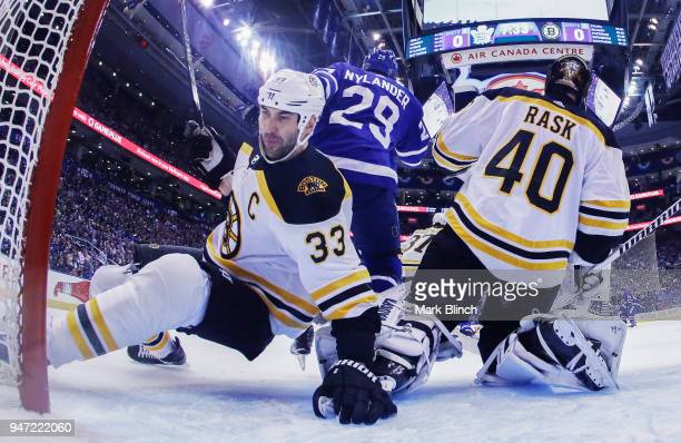Zdeno Chara of the Boston Bruins falls behind teammate Tuukka Rask and William Nylander of the Toronto Maple Leafs in Game Three of the Eastern...