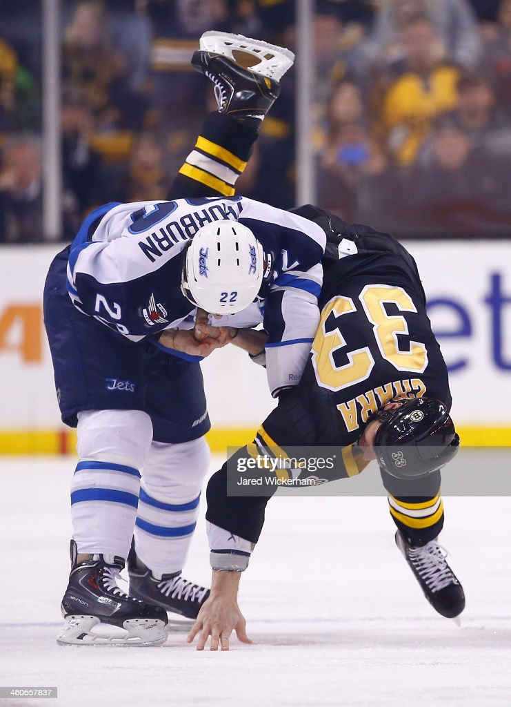 Zdeno Chara #33 of the Boston Bruins fights Chris Thorburn #22 of the Winnipeg Jets in the first period during the game at TD Garden on January 4, 2014 in Boston, Massachusetts.