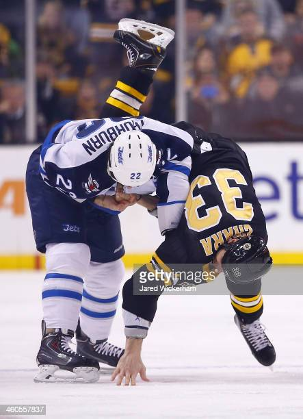 Zdeno Chara of the Boston Bruins fights Chris Thorburn of the Winnipeg Jets in the first period during the game at TD Garden on January 4 2014 in...
