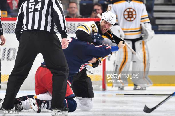 Zdeno Chara of the Boston Bruins fights Josh Anderson of the Columbus Blue Jackets during the second period of a game on October 30 2017 at...