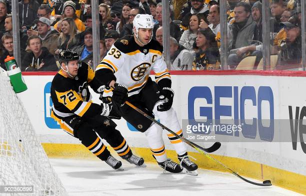 Zdeno Chara of the Boston Bruins handles the puck against Patric Hornqvist of the Pittsburgh Penguins at PPG Paints Arena on January 7 2018 in...