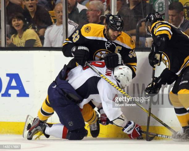 Zdeno Chara of the Boston Bruins hits Alex Ovechkin of the Washington Capitals along the boards during the first period in Game Five of the Eastern...