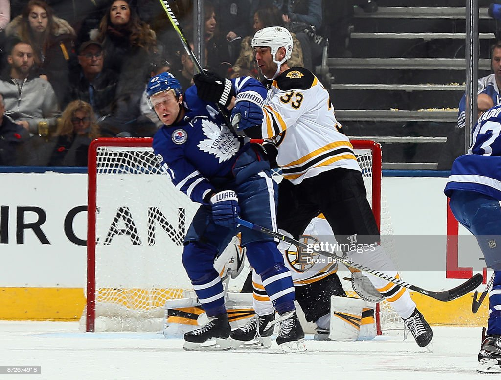 Zdeno Chara #33 of the Boston Bruins hits Leo Komarov #47 of the Toronto Maple Leafs during the first period at the Air Canada Centre on November 10, 2017 in Toronto, Canada.