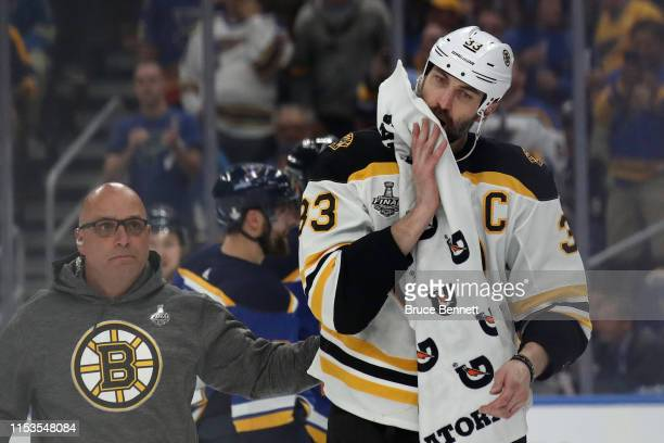 Zdeno Chara of the Boston Bruins is attended to after being injured during the game against the St Louis Blues in Game Four of the 2019 NHL Stanley...