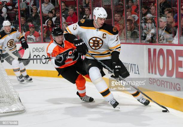 Zdeno Chara of the Boston Bruins is pursued by Cluade Giroux of the Philadelphia Flyers on October 22, 2009 at the Wachovia Center in Philadelphia,...