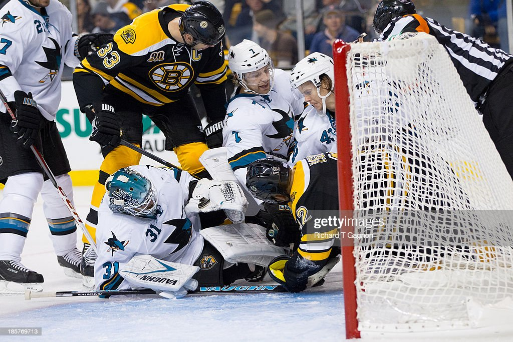 Zdeno Chara #33 of the Boston Bruins joins the pile of players including Jarome Iginla #12 of the Boston Bruins Antti Niemi #31 of the San Jose Sharks, Brad Stuart #7 of the San Jose Sharks and John McCarthy #43 of the San Jose Sharks during the third period of an NHL hockey game on October 24, 2013 at TD Garden in Boston, Massachusetts. The Bruins won 2-1 on a goal with 0.8 seconds remaining by David Krejci.