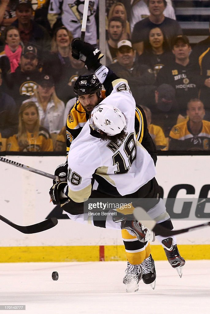 Zdeno Chara #33 of the Boston Bruins knocks over James Neal #18 of the Pittsburgh Penguins in the third period in Game Four of the Eastern Conference Final during the 2013 NHL Stanley Cup Playoffs at the TD Garden on June 7, 2013 in Boston, United States.