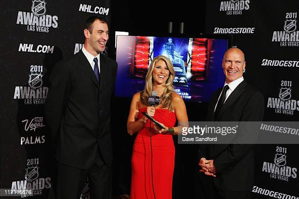 Zdeno Chara of the Boston Bruins NHL Network reporter Michelle Beisner and former NHL player Mark Messier have a laugh during the 2011 NHL Awards at...