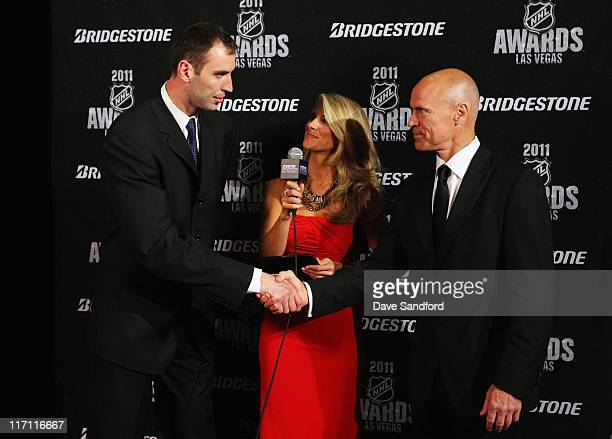 Zdeno Chara of the Boston Bruins shakes hands with former NHL player Mark Messier during the 2011 NHL Awards at The Pearl concert theater at the...