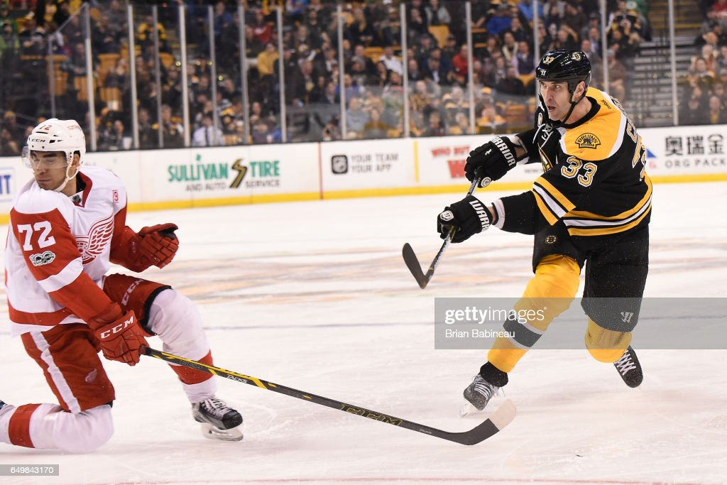 Zdeno Chara #33 of the Boston Bruins shoots the puck against Andreas Athanasiou #72 of the Detroit Red Wings at the TD Garden on March 8, 2017 in Boston, Massachusetts.