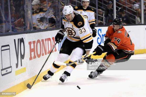 Zdeno Chara of the Boston Bruins skates past Joseph Cramarossa of the Anaheim Ducks during the first period of a game at Honda Center on February 22...