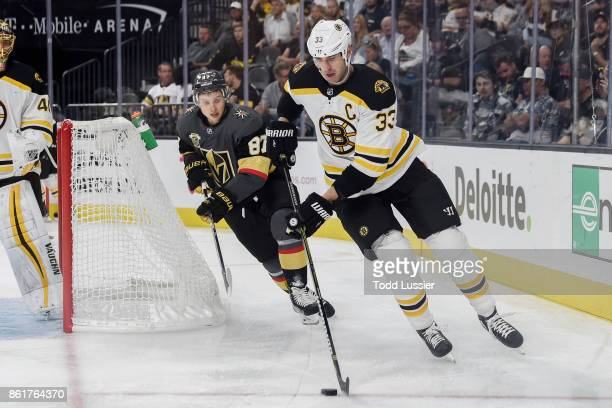 Zdeno Chara of the Boston Bruins skates with the puck while Vadim Shipachyov of the Vegas Golden Knights defends during the game at TMobile Arena on...