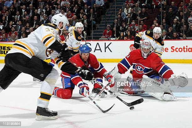 Zdeno Chara of the Boston Bruins take a shot on goalie Carey Price of the Montreal Canadiens in Game Six of the Eastern Conference Quarterfinals...