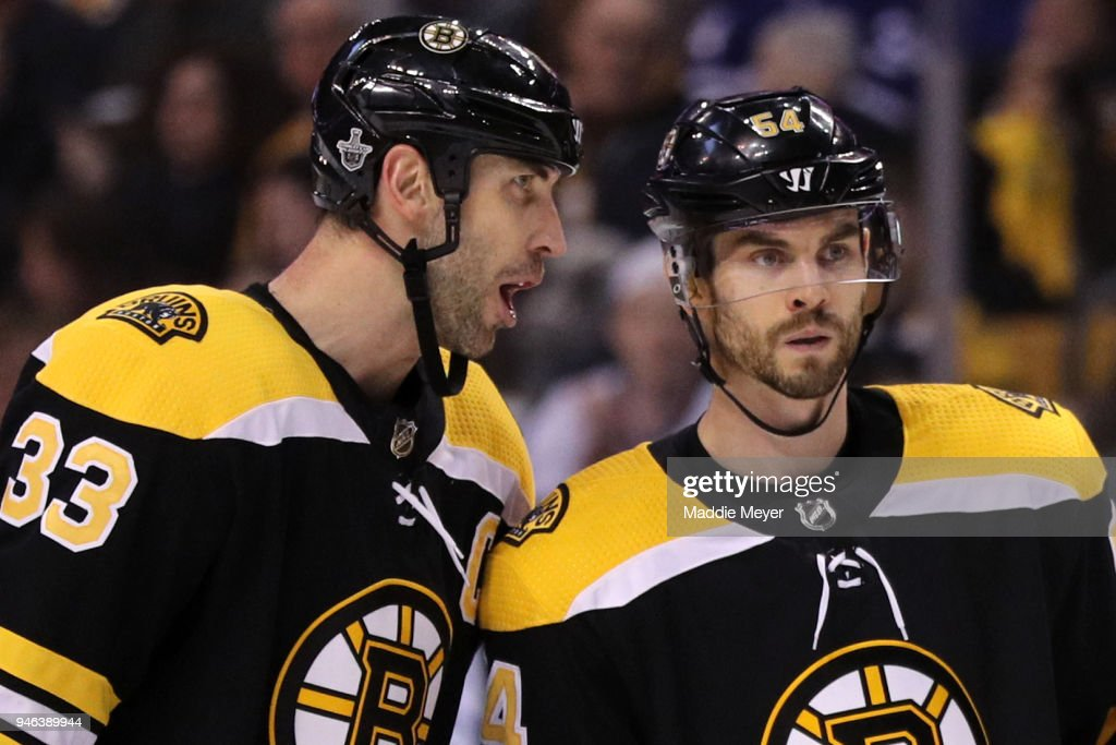 Zdeno Chara #33 of the Boston Bruins talks to Adam McQuaid #54 during the second period of Game Two of the Eastern Conference First Round against the Toronto Maple Leafs during the 2018 NHL Stanley Cup Playoffs at TD Garden on April 14, 2018 in Boston, Massachusetts.