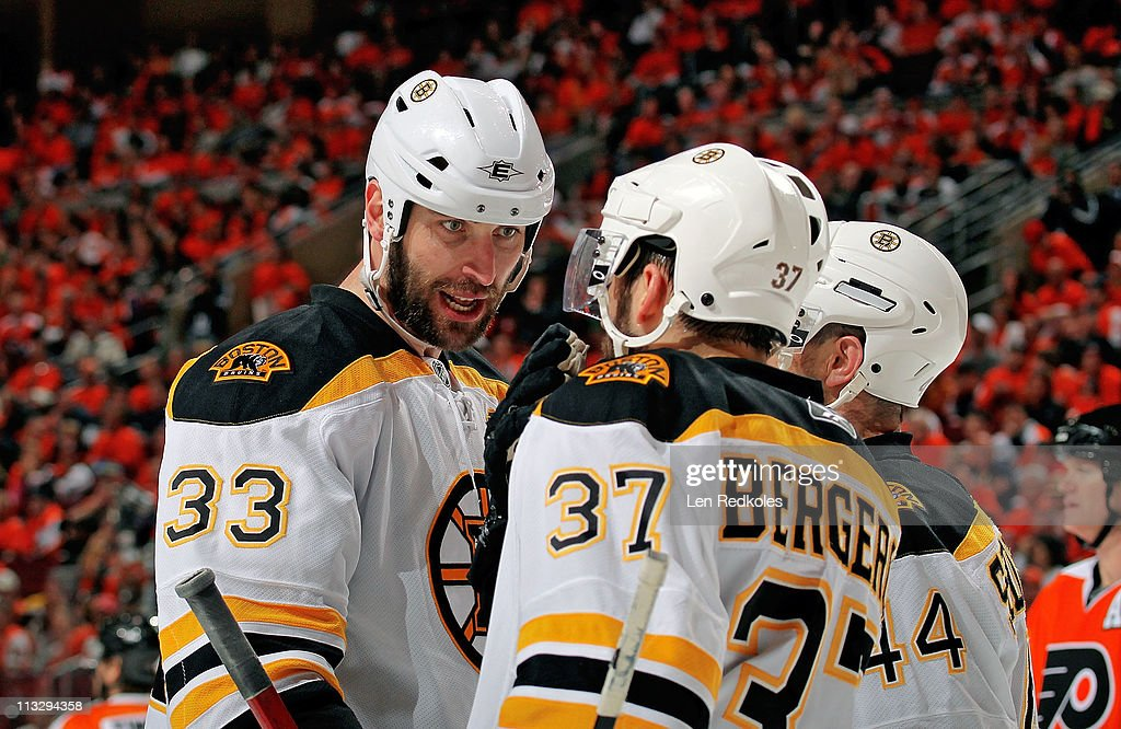 Zdeno Chara #33 of the Boston Bruins talks to teammates Patrice Bergeron #37 and Dennis Seidenberg #44 during a stoppage in play against the Philadelphia Flyers in Game One of the Eastern Conference Semifinals during the 2011 NHL Stanley Cup Playoffs at the Wells Fargo Center on April 30, 2011 in Philadelphia, Pennsylvania.