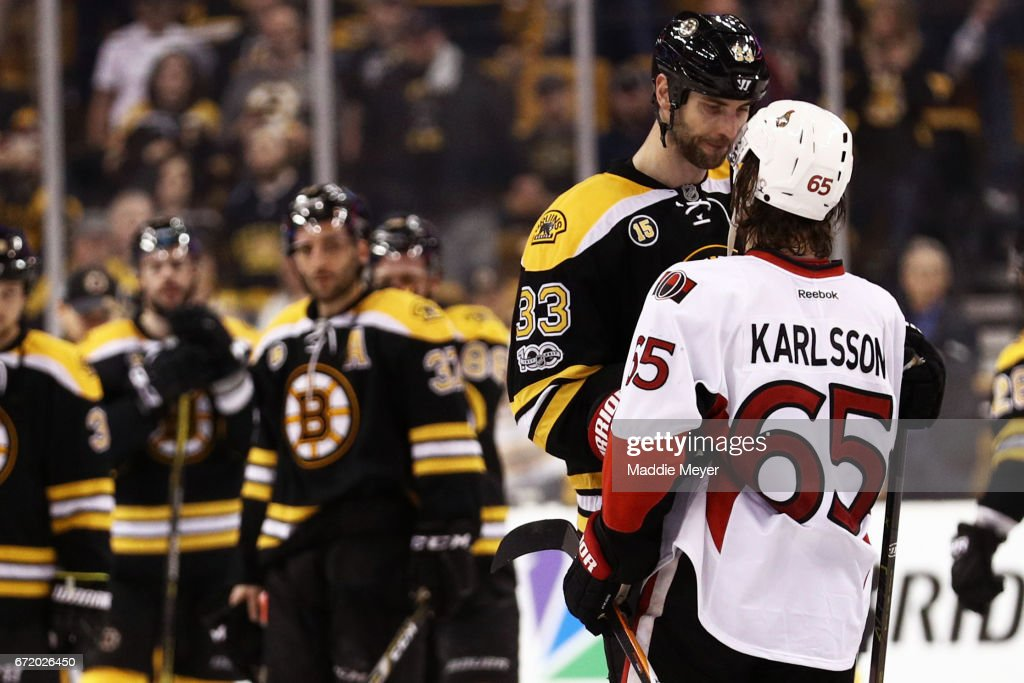 Zdeno Chara #33 of the Boston Bruins talks with Erik Karlsson #65 of the Ottawa Senators after the Senators defeat the Bruins 3-2 in overtime of Game Six of the Eastern Conference First Round during the 2017 NHL Stanley Cup Playoffs at TD Garden on April 23, 2017 in Boston, Massachusetts.
