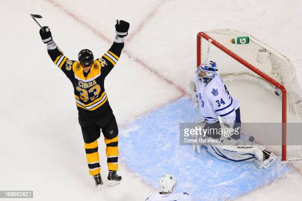 Zdeno Chara of the Boston Bruins throws his arms up after a goal against James Reimer of the Toronto Maple Leafs in Game Seven of the Eastern...